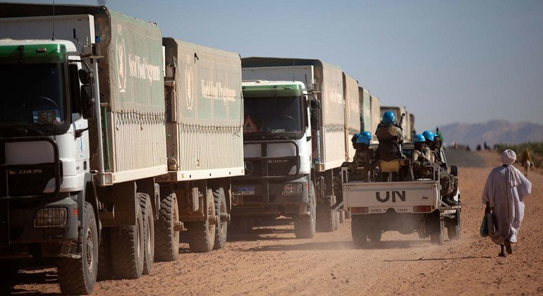 UNAMID troops from Ethiopia and Rwanda escort World Food Programme (WFP) trucks during a trip from El Fasher to Shangil Tobaya, in North Darfur, in February 2014. The journey, nearly 100 kilometres, took more than 8 hours due to difficult road conditions.