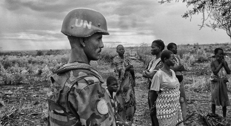 An Ethiopian peacekeeper with UNMISS accompanies internally displaced women as they collect firewood in Juba. Some of the collected firewood will be used for cooking; some will be sold in the market.