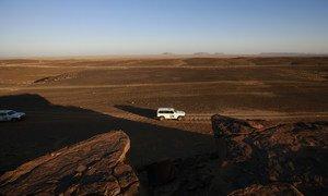 A MINURSO ceasefire monitoring team drives through the Smara region in Western Sahara.