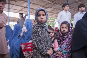 Afghan refugees at a UNHCR voluntary repatriation centre in the Pakistani city of Peshawar. After decades in Pakistan, more Afghan refugees have begun to return.