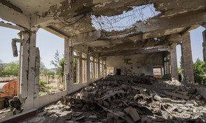 A man sits in the destroyed, former Assembly Hall of the Governor of Saada. Since the escalation of conflict in Yemen, millions have been forced to rely on life-saving assistance and much of the country lies in ruins.