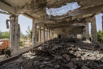 A military guard sits in the former Assembly Hall of the Governor of Saada, which now lies in ruins. Since the Yemen conflict escalated two years ago, much of the city's infrastructure has been destroyed.