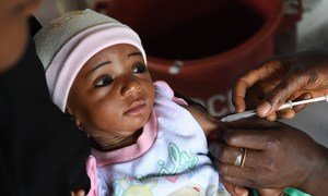 A little girl being vaccinated in the town of Bouaké, in Côte d'Ivoire. Immunization in the country is free for children bellow one year old, but three out of five children do not get vaccinated before their first birthday.