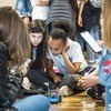 On Girls in ICT Day, these young girls, learning programming and coding for a small robot, are among over 150 participants taking part in interactive workshops and mentoring sessions at ITU headquarters in Geneva, Switzerland.