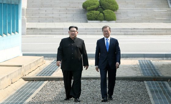 President Moon Jae-in (right) of the Republic of Korea greets Chairman of the State Affairs Commission Kim Jong-Un of the DPRK in Panmunjeom, during the April 2018 inter-Korean summit.