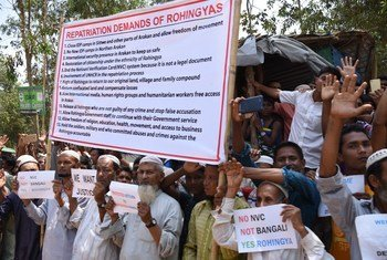 Rohingya refugees in Kutupalong settlement in Cox's Bazar, Bangladesh, hold a sign demanding their repatriation to their homeland in Myanmar.