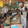 Bishow Parajuli (left), UN Resident Coordinator and Resident Representative for the UN Development Programme (UNDP) in Zimbabwe, visiting one of the UN supported resilience and community asset building projects in Masvingo Province, Zimbabwe.