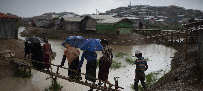 Rohingya refugees endure a heavy rain in Balukhali camp, in Cox's Bazaar District, Bangladesh on 4 May 2018.