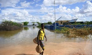 A young boy walks through a flooded residential area in the Somali town of Belet Weyne on 30 April 2018. Belet Weyne is currently experiencing severe flooding, and over 150,000 people have been displaced.
