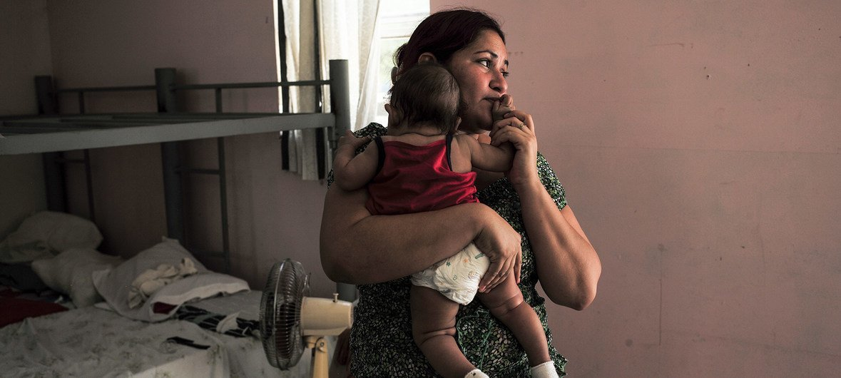 An Honduran refugee with her 4 month old baby girl at the Senda de Vida shelter in Reynosa, Mexico, 2016. The flow of refugee and migrant children from Central America making their way to the United States shows no sign of letting up, despite the dangers of the journey.