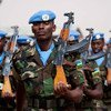 Rwandan peacekeepers march at UNAMID's headquarters in El Fasher during the 2012 commemoration of the International Day of United Nations Peacekeepers.