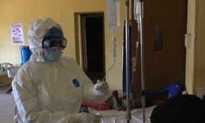 A health worker checks a Lassa fever patient's medication.