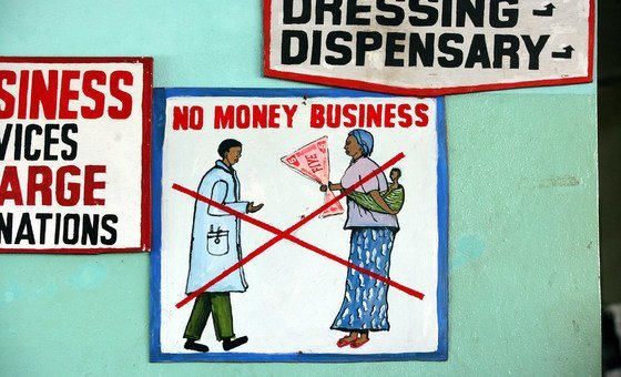 A sign outside a hospital in the Liberian capital, Monrovia, urges patients not to bribe doctors or other staff for any services. The UNICEF-supported hospital offers its services for free.