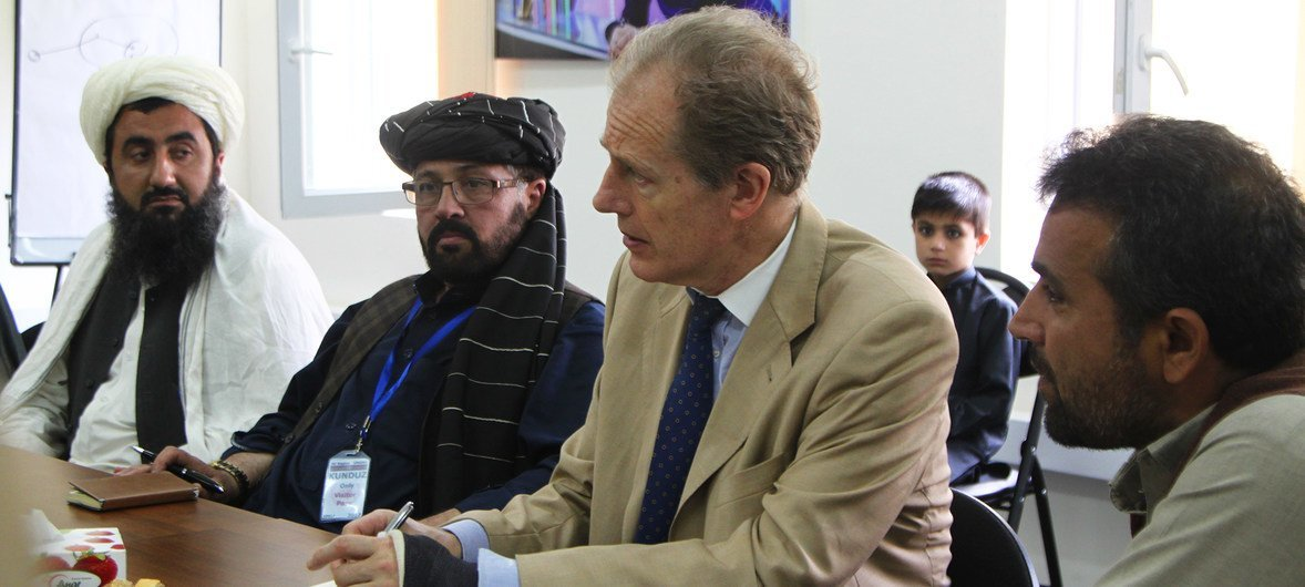 The Assistant Secretary-General for Human Rights, Andrew Gilmour (c) meets Dasht-e-Archi elders in Afghanistan