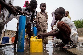 Children collect water in Maiduguri, capital of Borno state in north-east Nigeria, 2017. Each year, the countries around Lake Chad (Niger, Nigeria, Chad and Cameroon) suffer from severe flooding as part of the seasonal rains in the region. UNICEF warns that during the rainy season many children are at increased risk of waterborne diseases, like cholera, diarrhoea and malaria.