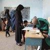 阿富汗人民正在进行选民登记,以便在2018年10月举行的选举中行使民主投票权。