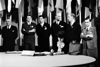 Dr. Bertha Lutz signing the UN Charter at a ceremony held at the Veterans' War Memorial Building on 26 June 1945.