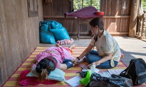 Nhek Chande, a secondary midwife at a local health centre in rural Cambodia conducts a prenatal check-up for a pregnant woman. Midwives play an important role in the communities, helping mothers, and expectant-mothers, make informed, healthy choices.