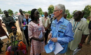 Mark Lowcock, USG for Humanitarian Affairs and Emergency Relief Coordinator, discusses the health and nutrition situation among people displaced by conflict in South Sudan, with Dr. Joice Dominic in Gezira, near Yei Town.