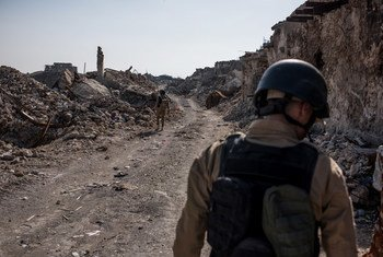 UN Mine Action Service (UNMAS) contractors conduct clearance operations in the heavily destroyed Old City of Mosul, Iraq, 10 March 2018.