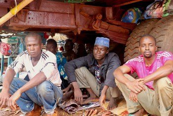 Moussa, Idriss and Mahmoud (left to right) have found shelter under a truck in Bangassou in the Central African Republic after they were displaced by violence. (file)