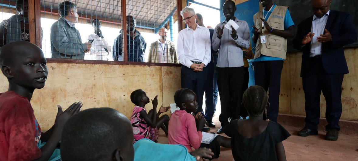 Emergency Relief Coordinator Mark Lowcock meets with children at the a primary school at the UN House Protection of Civilians site in Juba, South Sudan. More than 3,000 children attend the school, which is supported by an NGO.