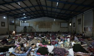 Migrants lie on mattresses inside a detention centre, located in Libya. (file)