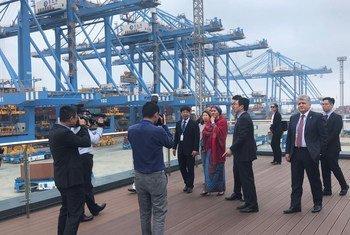The UN Deputy Secretary-General, Amina Mohammed (centre) visits Qingdao Port in China