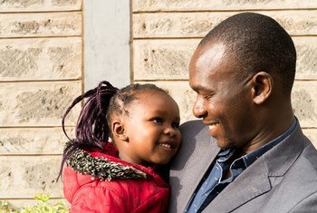 A three-year-old and her father outside of the school building in Kibera, Nairobi, Kenya, 16 May 2017.
