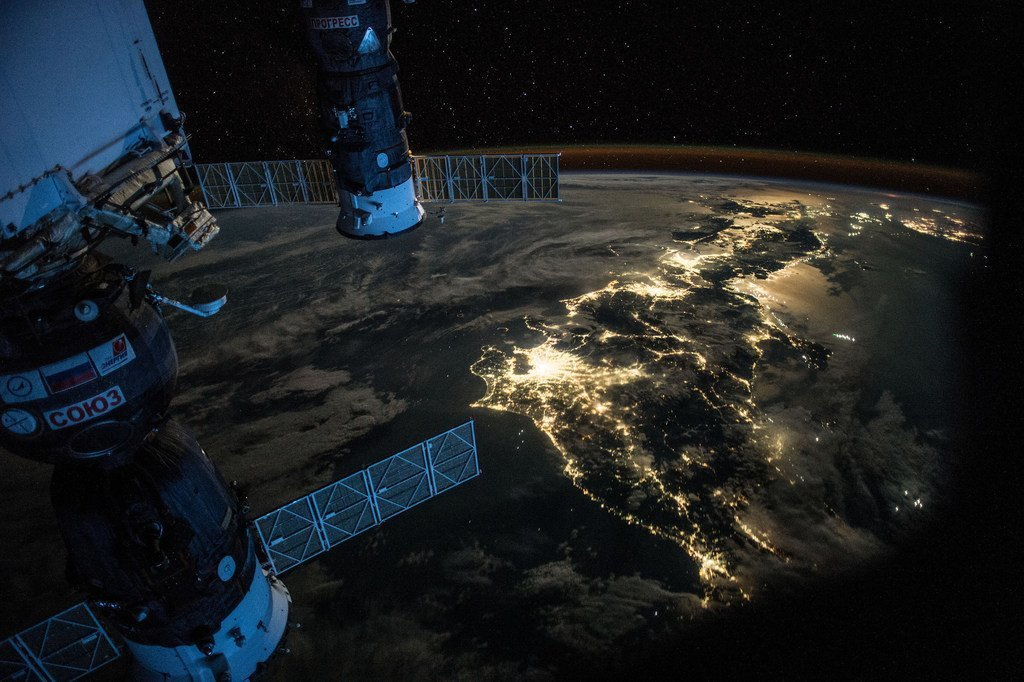 A night Earth observation photograph taken from the International Space Station, as it passes over Japan. Also in the picture are a Soyuz Spacecraft, connected to the Station's Mini Research Module 1, and a Progress Spacecraft.