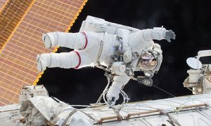 NASA astronaut Scott Kelly is seen floating during a spacewalk on 21  December 2015 as he and fellow astronaut Tim Kopra released brake handles on crew equipment carts on either side of the space station.