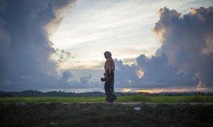 A Rohingya woman crosses the border from Myanmar into Bangladesh near the village of Anzuman Para in Palong Khali.