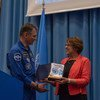 European Space Agency astronaut Paolo Nespoli presents the SDG flag he flew abroad the International Space Station to UNOOSA Director Simonetta Di Pippo.