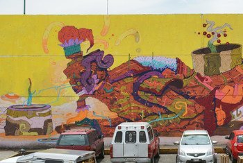 Mural inspired by the Sustainable Development Goals on the walls of Central de Abastos, the largest wholesale market in Latin America.