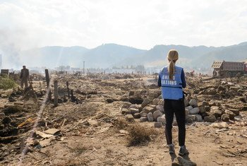 A UN aid worker surveys the damage in the aftermath of devastating floods that hit the Democratic People's Republic of Korea (DPRK) in September 2016.