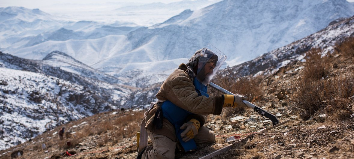 An explosives specialist conducts mine clearance operations after detecting a piece of metal in Afghanistan, where 2,300 casualties as a result of landmines were reported in 2017 alone.