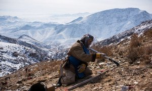An explosives specialist conducts mine clearance operations after detecting a piece of metal in the mountains near Kabul, Afghanistan.