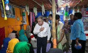 Secretary-General António Guterres (center) meets with Rohingya refugees in Cox's Bazaar, Bangladesh. (July 2018)