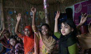 Young girls at a Women-Friendly Space at a Rohingya refugee settlement in Cox's Bazar, Bangladesh. The Spaces offer women and girls a safe haven where they can find sanctuary and support.