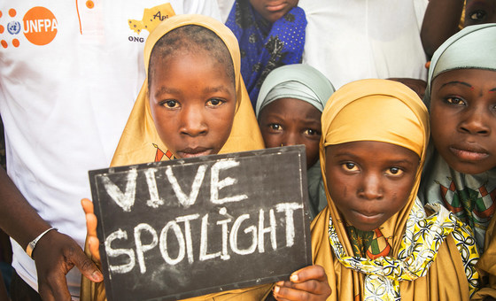Young girls in the village of Danja in Niger hold a sign in support of the Spotlight Initiative a European Union and UN fund supporting the Sustainable Development Goals.