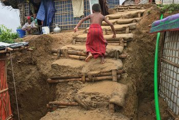 A Rohingya boy walks up steps in a rain-damaged section of the Chakmarkul refugee settlement, Cox's Bazar District, Bangladesh. The country hosts a population of Rohingya refugees that has surged to over 900,000 since August 2017.