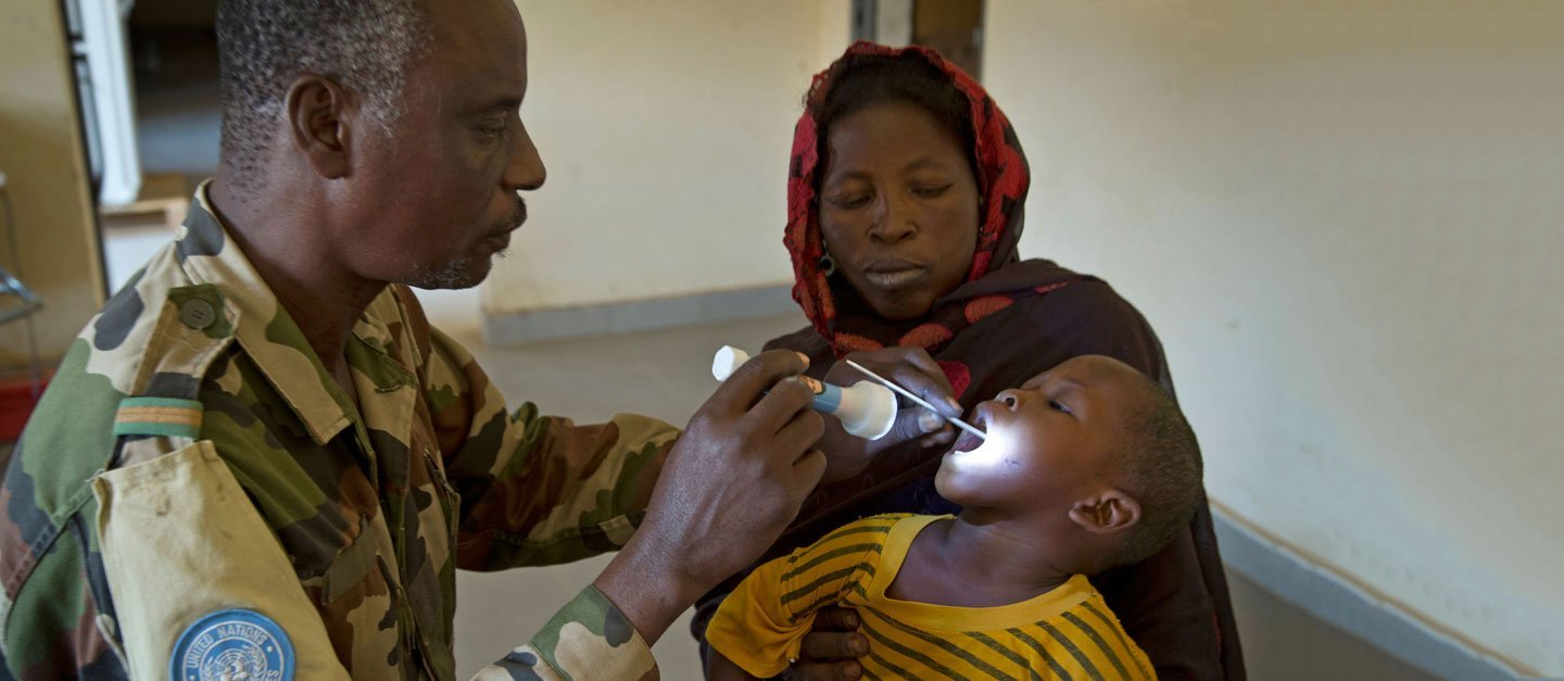 A Malian child receives a free consultation at a medical clinic in Gao run by the Nigerien contingent of the UN mission in the country, known by its French acronym, MINUSMA.