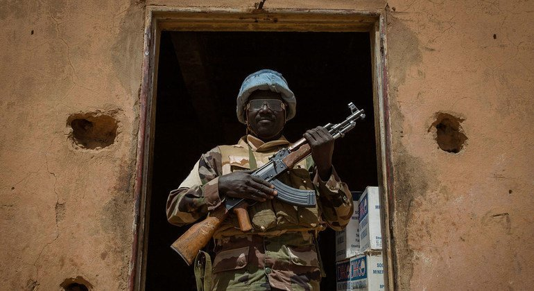 In places like Mali, UN peacekeepers protect civilians against attacks and support the delivery of crucial humanitarian assistance. A peacekeeper with the Nigerien contingent during a visit to Menaka, in eastern Mali, in February 2015.