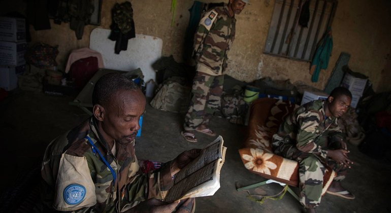 A MINUSMA peacekeeper from Niger catches up on reading during some downtime in Menaka, in eastern Mali, in February 2015.