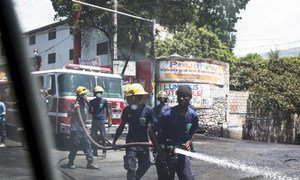A brigade works to clean the streets in Port-au-Prince, Haiti, following three days of violent protests.