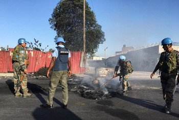 United Nations Mission for Justice Support in Haiti (MINUJUSTH) and United Nations Police (UNPOL) personnel attend to the remnants of three days of violent protests in Port-au-Prince, Haiti, 9 July 2018.