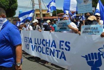 A Managua, des manifestants participent à une marche pour exiger la fin de la violence au Nicaragua.