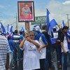 Manifestantes en Managua participan en una marcha para pedir el fin de la violencia en Nicaragua