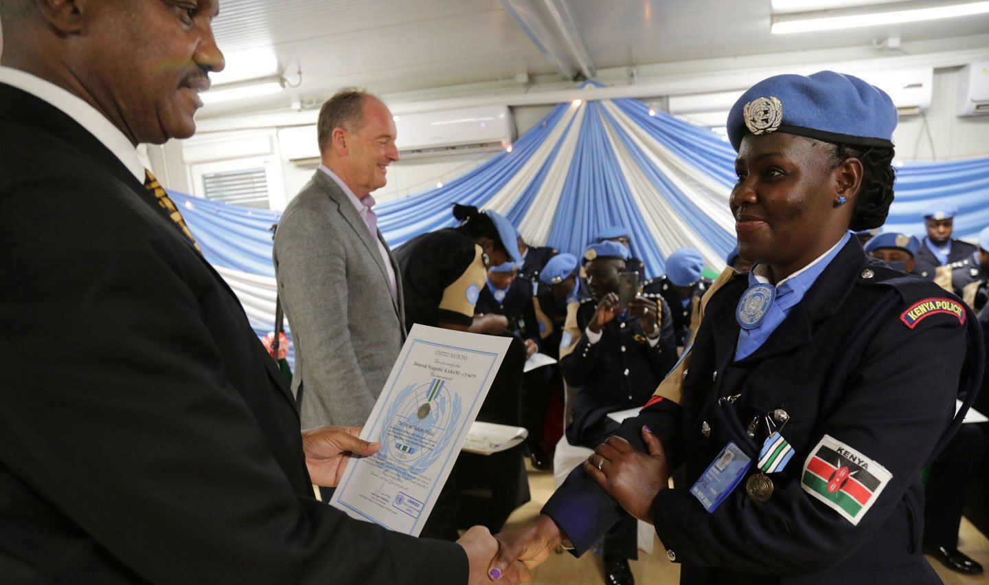 Kenyan police officers with the UN Mission in South Sudan are honoured in June 2018 for their service, including community policing and ensuring the safety of displaced people.