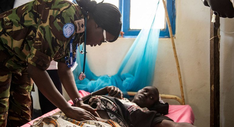 Kenyan peacekeepers serving in South Sudan's Warrap State, Medical Officer Captain Njuki, examines a pregnant woman suffering from malaria, a condition which can sometimes lead to miscarriages.